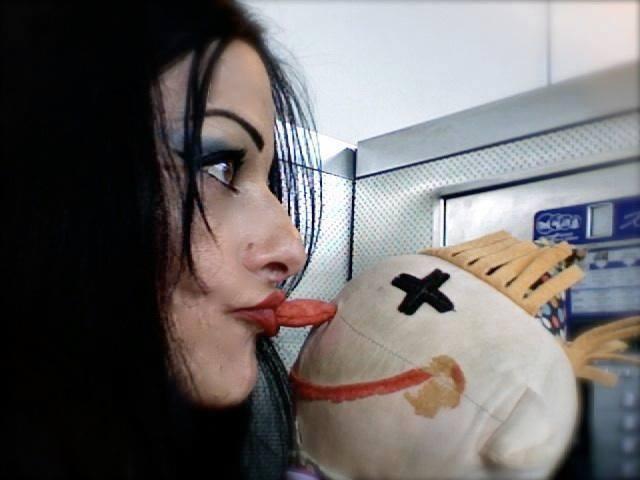 Nona Hagen kisses the cross puppet