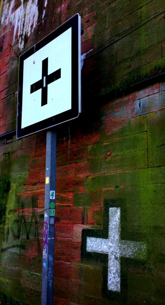 Black Cross - White Cross: A traffic sign and graffiti beneath a Rhine bridge in Mainz, Victor-Hugo-Ufer